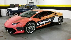 A car wrapped in the style of Tracer from Overwatch.