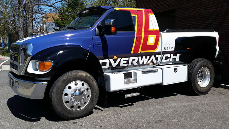 A truck wrapped in the style of Soldier 76 from Overwatch